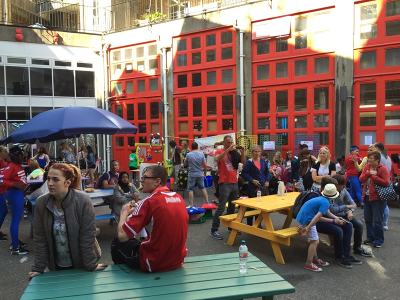 A busy view of The Station courtyard, full of people